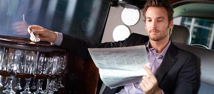 reading-business-section-in-limo